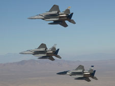 A trio of F-15D Eagles bank right as they pass in review over Edwards Air Force Base upon their arrival at NASA's Dryden Flight Research Center Sept. 21.