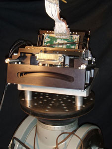 A laboratory test version of the new AirMSPI camera, called GroundMSPI, is shown on its test pedestal. The GroundMSPI has the same design and same set of spectral bands and polarization channels as AirMSPI.