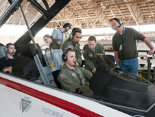 A software-development team prepares for a research flight with a new tool. In the aircraft, from left, are Ryan McMahon and David Marten. Outside the cockpit, from left, are Katherine Ryan, Gianmarco Di Loreto, Jade Lemery and Bruce Cogan.