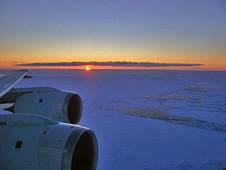With the sun on the horizon, NASA's DC-8 flies over Antarctica's Weddell Sea.