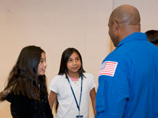 Seventh-grade students Diamond Luong and Jacqueline Ibarra chat with former NASA space shuttle astronaut and NASAs current Associate Administrator for Education Leland Melvin following his presentation at Shadow Hills Intermediate School in Palmdale Dec. 8.
