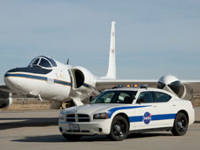 NASA's Dodge Charger safety vehicle is pictured with one of NASA's ER-2 high-altitude Earth science aircraft on the ramp at the agency's Dryden Aircraft Operations Facility in Palmdale, Calif.