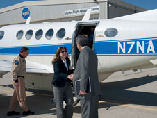 David McBride, Dryden center director, greets NASA Deputy Administrator Lori Garver as she arrives at the Dryden ramp.