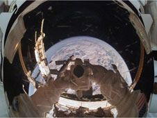view of earth from window of spacecraft