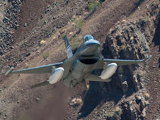 The Air Force F-16D ACAT aircraft flew at low levels through canyons and past peaks of the Sierra Nevada mountains