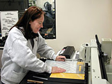 Technician at engraving station.