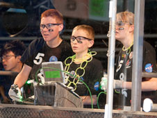 Members of Tehachapi Highs Cyber Penguins robotics team are a study in concentration as they maneuver their robot during the San Diego regional competition in March 2011.