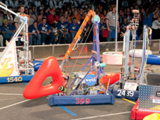 Lancaster High Eagle Robotics James Bot robot mixes it up with other robots during a match at the San Diego regional robotics tourney in March 2011.