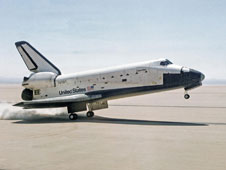 Space Shuttle Columbia touches down on lakebed runway 23 at Edwards Air Force Base, Calif., to conclude STS-1, the first orbital shuttle mission on April 14, 1981.