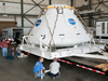 Orion prototype capsule of the Multi-Purpose Crew Vehicle is lowered onto the trailer.