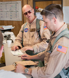 NASA research pilot Nils Larson and flight engineer Mike Holtz review the flight test cards before a research flight in a NASA F/A-18.
