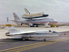 NASA's modified F-8C Digital Fly-By-Wire research aircraft was photographed in front of the prototype space shuttle Enterprise mated to Boeing 747 SCA.