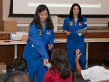 AERO Institute student interns Cynthia Wong and Elina Cruz introduced young visitors to two local aerospace heroes, Joe Walker and Pete Knight, and also presented basic information about flying during a recent Thursday Night on the Square program.