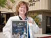Katie Kirk of Palmdale, a nurse practioner at Dryden's Health Unit, displays her NASA Space Flight Awareness Honoree Award.