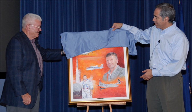 Retired NASA astronaut and research pilot Fred Haise and NASA Dryden Flight Research Center director David McBride unveil a new historical painting by noted artist Bob Schaar of Haise and several of the aerospace vehicles he flew during his long career following Haise' colloquium presentation at NAS