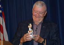 Retired NASA astronaut and research pilot Fred Haise mugs with a