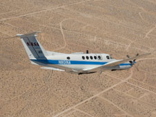 NASA's Beechcraft B200 Super King Air N801NA carries the Autonomous Modular Sensor, a high-tech thermal-infrared scanning instrument that can see through smoke and haze to aid fire fighters in battling wildfires.