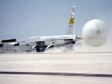 NASA's NB-52B research aircraft deploys an experimental drag chute just after landing on Rogers Dry Lake at Edwards Air Force Base, Calif., on Aug. 2, 1990.