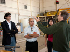 Craig Stephens makes a point during a tour of the Dryden Flight Loads Laboratory.