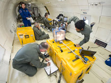 University of Florida students maximize their exposure to zero gravity to conduct a flight experiment aboard the Zero-G parabolic aircraft.