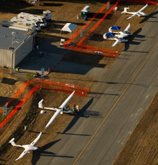 All four experimental aircraft that participated in the Green Flight Challenge are lined up adjacent to a taxiway at the Charles M. Schulz Sonoma County Airport in Santa Rosa, Calif. From lower left to upper right are the PhoEnix, EcoEagle, Taurus G4 and e-Genius aircraft.