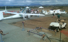 The world's first aircraft electric charging station at the Santa Rosa Airport was used to charge the batteries of the prototype electric aircraft entered in the Green Flight Challenge, including the eGenius design at left and the twin-fuselage Pipistrel Taurus4 at right.