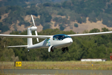 The eGenius electric-powered aircraft takes off from the Santa Rosa Airport during a Green Flight Challenge flight.