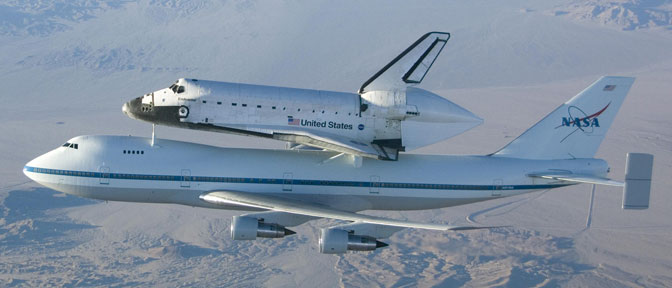 Space shuttle Endeavour is carried on one of NASA's modified Boeing 747 Shuttle Carrier Aircraft on a ferry flight back to the Kennedy Space Center in Florida after its last landing at Edwards Air Force Base in November 2008.