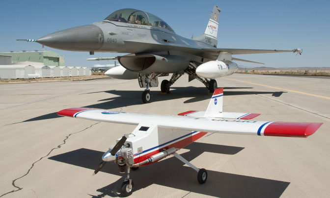 The modified DROID small UAV model aircraft in the foreground is being used as a test bed for further development of autonomous ground collision avoidance system software that was successfully flight-tested at NASA Dryden on the F-16D behind it in 2010.