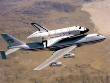 Challenger is mated with the NASA 747 Shuttle Carrier Aircraft for initial delivery to the Kennedy Space Center.
