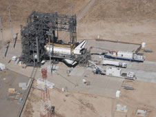 Discovery is surrounded by the Mate/DeMate Device gantry and ground support equipment at Dryden during processing for a ferry flight back to Kennedy Space Center, Fla.