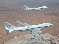 NASA's 747 Shuttle Carrier Aircraft No. 905, foreground, and No. 911, background, fly in formation