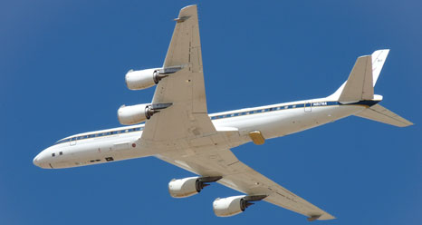 NASA's DC-8 airborne science laboratory soars over Dryden Flight Research Center on a test flight before its departure to Chile for the Fall 2011 IceBridge campaign
