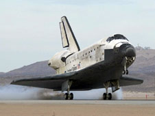 Space Shuttle Discovery touches down on Runway 22L at Edwards Air Force Base to conclude the almost 14-day STS-128 mission
