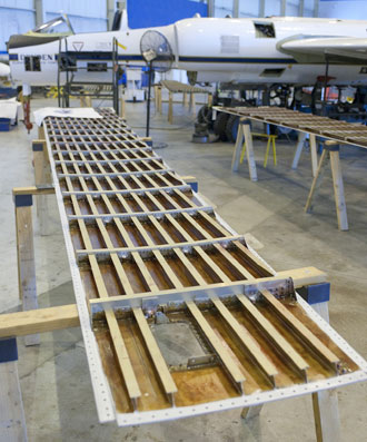 The top panel of a NASA ER-2s wing was removed for examination of the fuel lines and tanks within the wing and replacement of sealant during modified periodic maintenance.