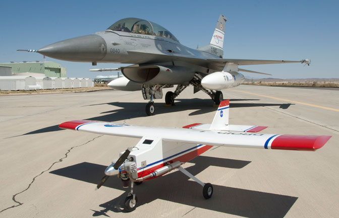 The modified DROID small UAV model aircraft in the foreground is being used as a test bed for further development of autonomous ground collision avoidance system software that was successfully flight-tested on the Air Force F-16D behind it at NASA Dryden in 2010.