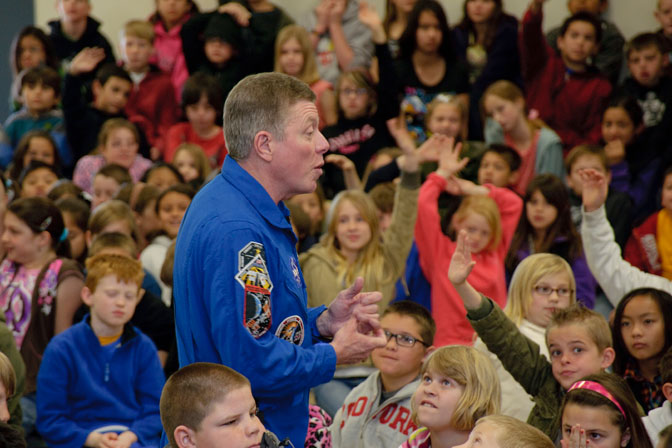 Surrounded by scores of students, NASA astronaut Mike Fossum was in his element as he explained his experiences as a member of the crew on two space shuttle missions and two expeditions on the International Space Station at Branch Elementary School on Edwards Air Force Base.