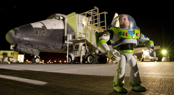 The Disney-Pixar Buzz Lightyear space ranger action figure disembarks from Space Shuttle Discovery following its landing at Edwards Air Force Base on Sept. 11, 2009.