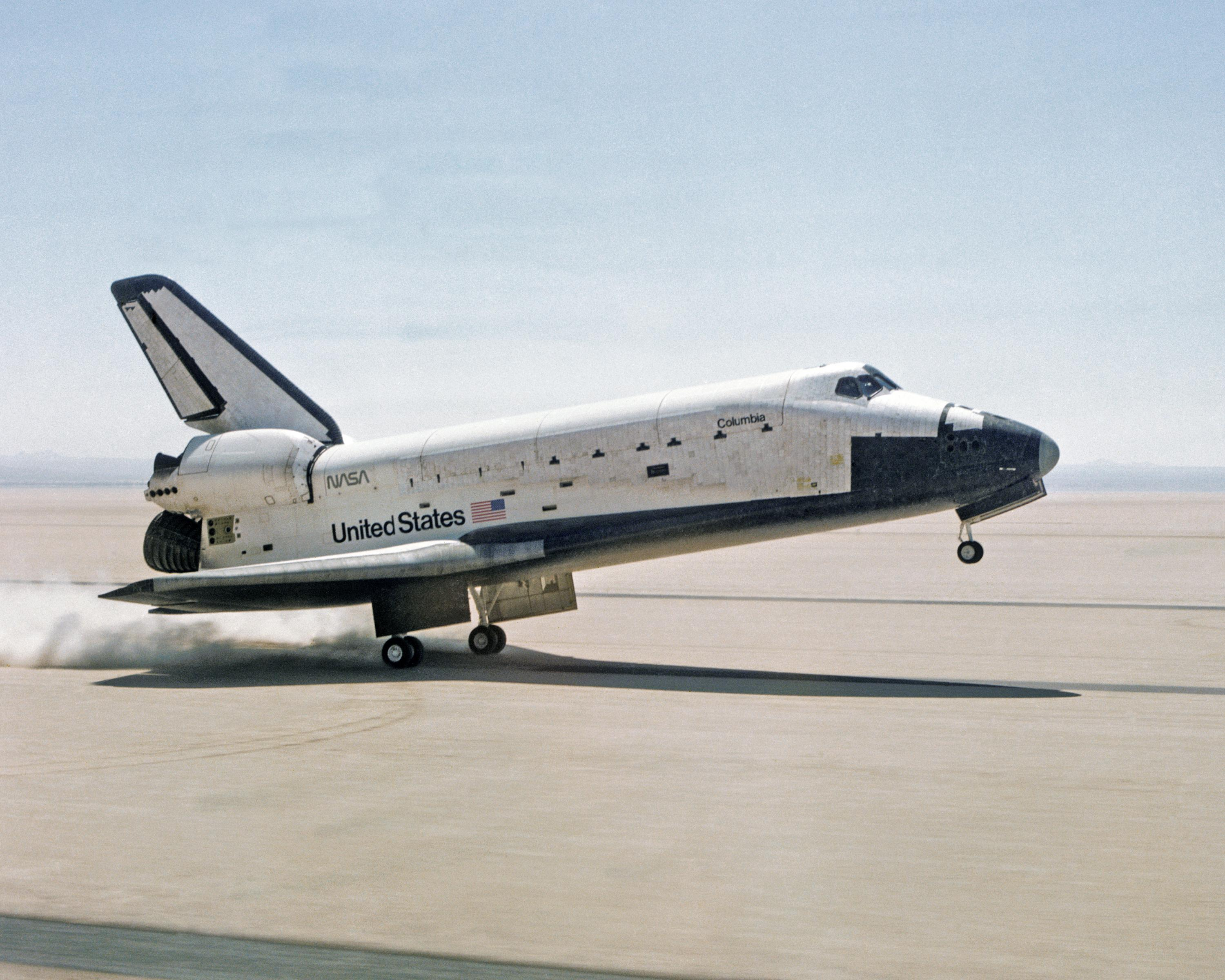 Space shuttle columbia touches down on lakebed runway 23 at edwards