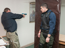 Protective Services trainer David Spencer, left, shows Anthony Garcia a good technique for spotting the suspect that gives the least view of the officer.