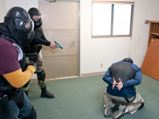 Protective Services officers find and capture a suspect in their training exercise.