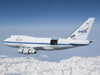 With the sliding door over its 17-ton infrared telescope wide open, NASA's Stratospheric Observatory for Infrared Astronomy – or SOFIA – soars over California's snow-covered Southern Sierras on a test flight in 2010