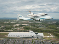 Discovery and the NASA 747 prepare to land at Dulles International Airport near Washington, D.C., but first fly by the Smithsonian National Air and Space Museum's Stephen F. Udvar-Hazy Center in Chantilly, Va., where it will be on display.