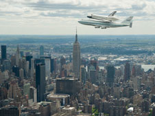 The Enterprise and NASA 747 fly by the Manhattan skyline on its way to the Intrepid Sea, Air and Space Museum, which is located in New York Harbor.