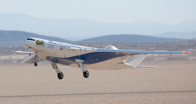 The remotely operated X-48C Blended Wing Body aircraft lifts off Rogers Dry Lake at Edwards Air Force Base, Calif., on its first test flight Aug. 7.
