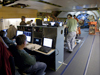 Astronomers and mission operations staff monitor data at their consoles during a science flight aboard the SOFIA flying observatory.
