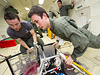 Boston University students Joshua Koerpel and Christopher Hoffman test a solar array deployment system for use on CubeSats as they float in very low gravity during a parabolic flight in Zero-G Corporation's modified Boeing 727 jetliner.