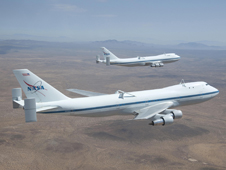 NASA's two modified Boeing 747 Shuttle Carrier Aircraft 905 (front) and 911 (rear) were captured by photographer Carla Thomas as they flew in formation over the Southern California high desert in the Edwards Air Force Base Test Range.