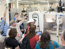 Social media fans attending the NASA Social at NASA's Dryden Flight Research Center found equipment in Dryden's Experimental Fabrication Shop a ready target for their smart phone cameras.