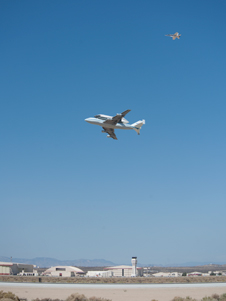 NASA's Shuttle Carrier Aircraft with the space shuttle Endeavour securely mounted on top makes a low-level flyby of the flight line prior to landing at Edwards Air Force Base after the third leg of its four-segment final ferry flight into history.